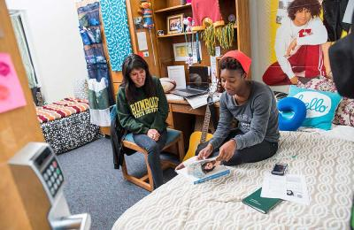 Students studying in Cypress residence hall.